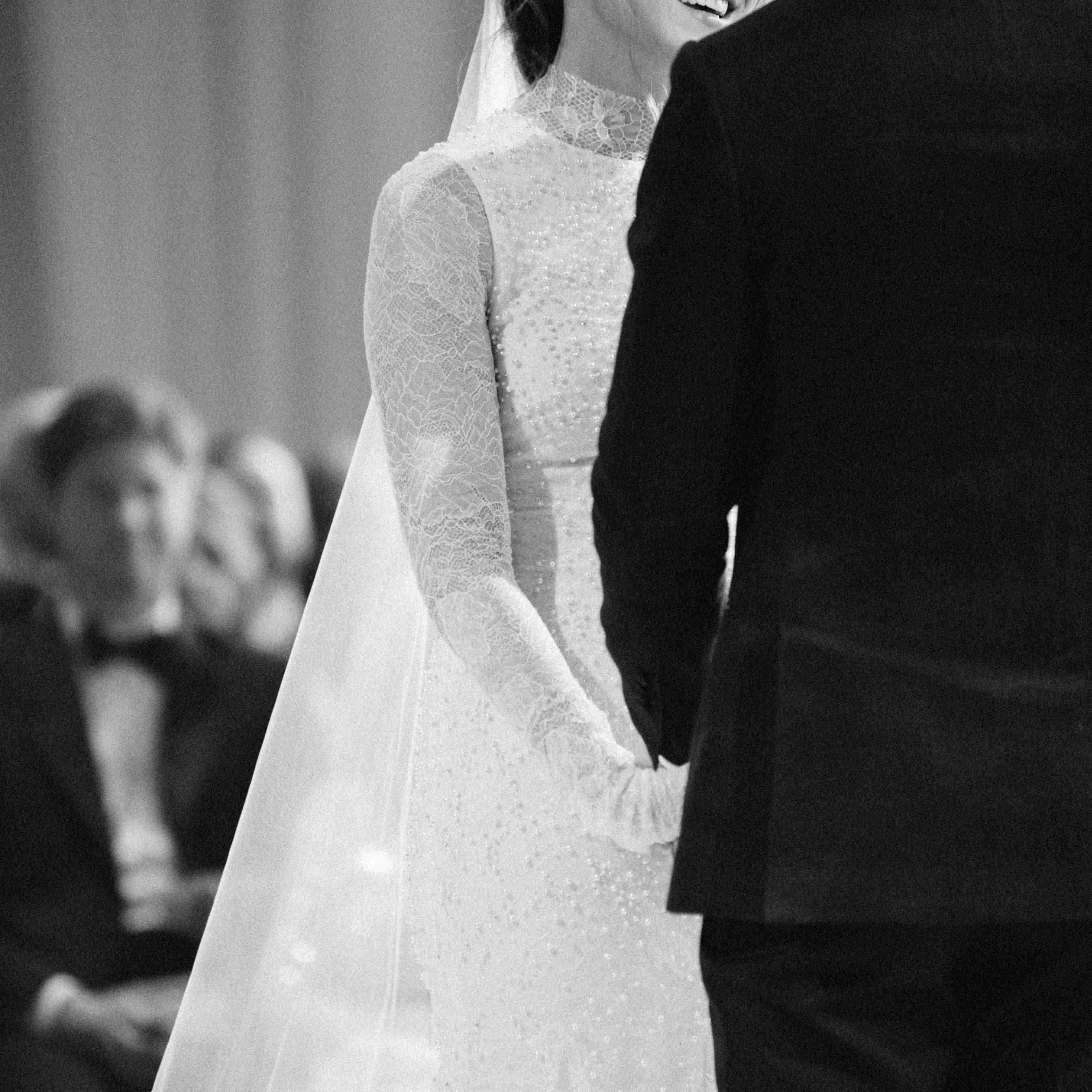 <p>Bride smiling at groom</p><br><br>