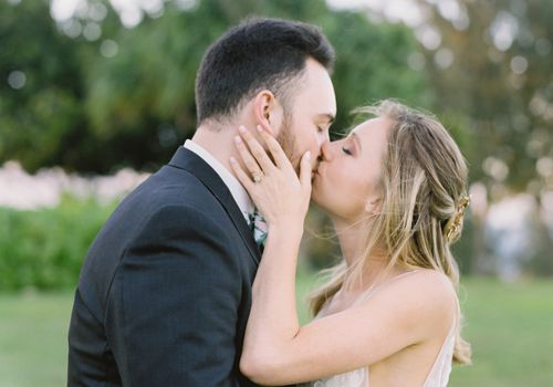 tropical maui wedding, bride and groom kissing