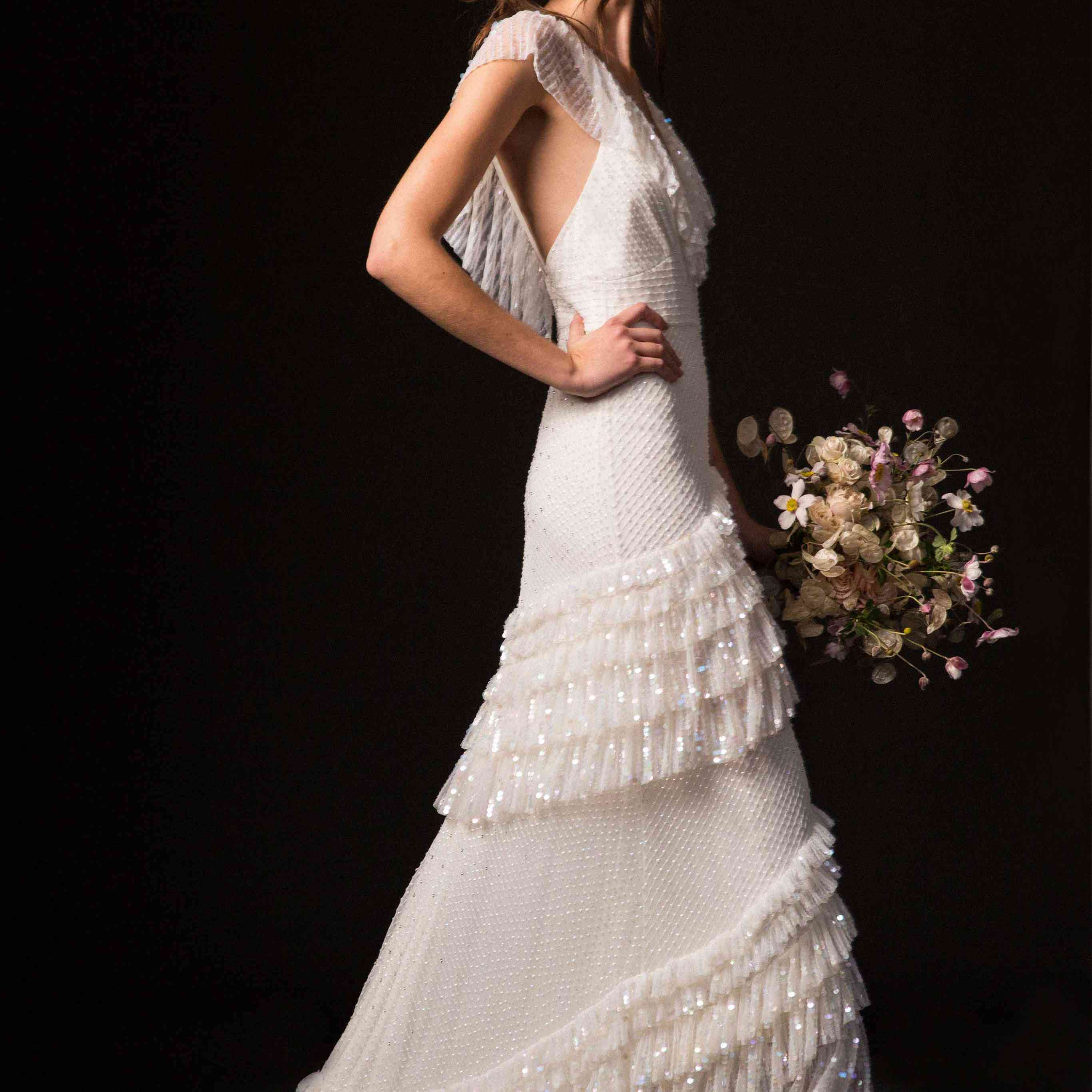 Model in ruffled wedding dress with sequins