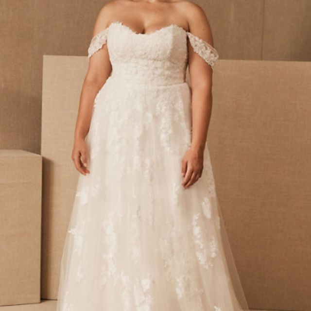 Plus size model in off-the-shoulder floral applique white wedding gown