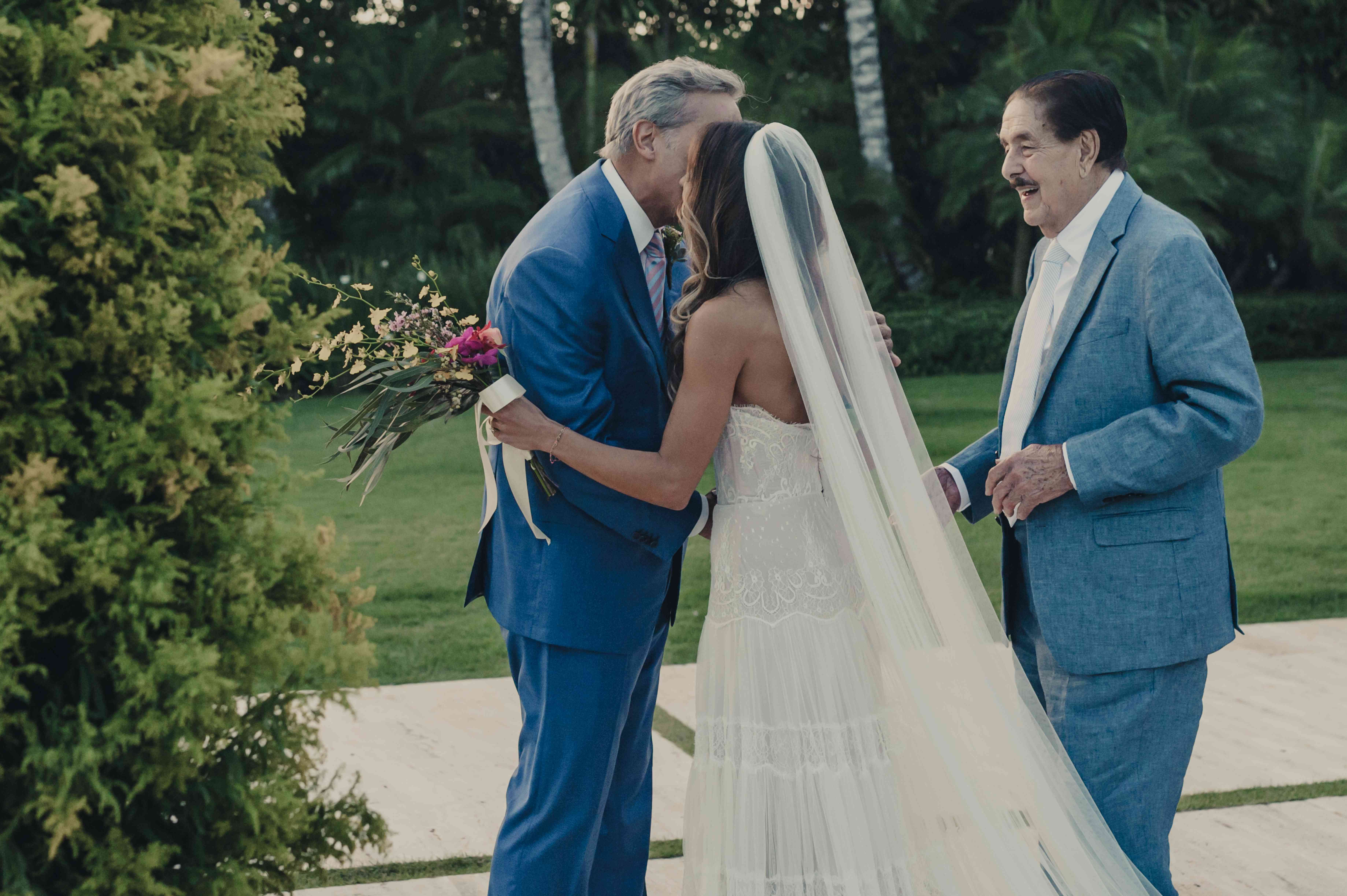 grandfather and father walking bride down aisle