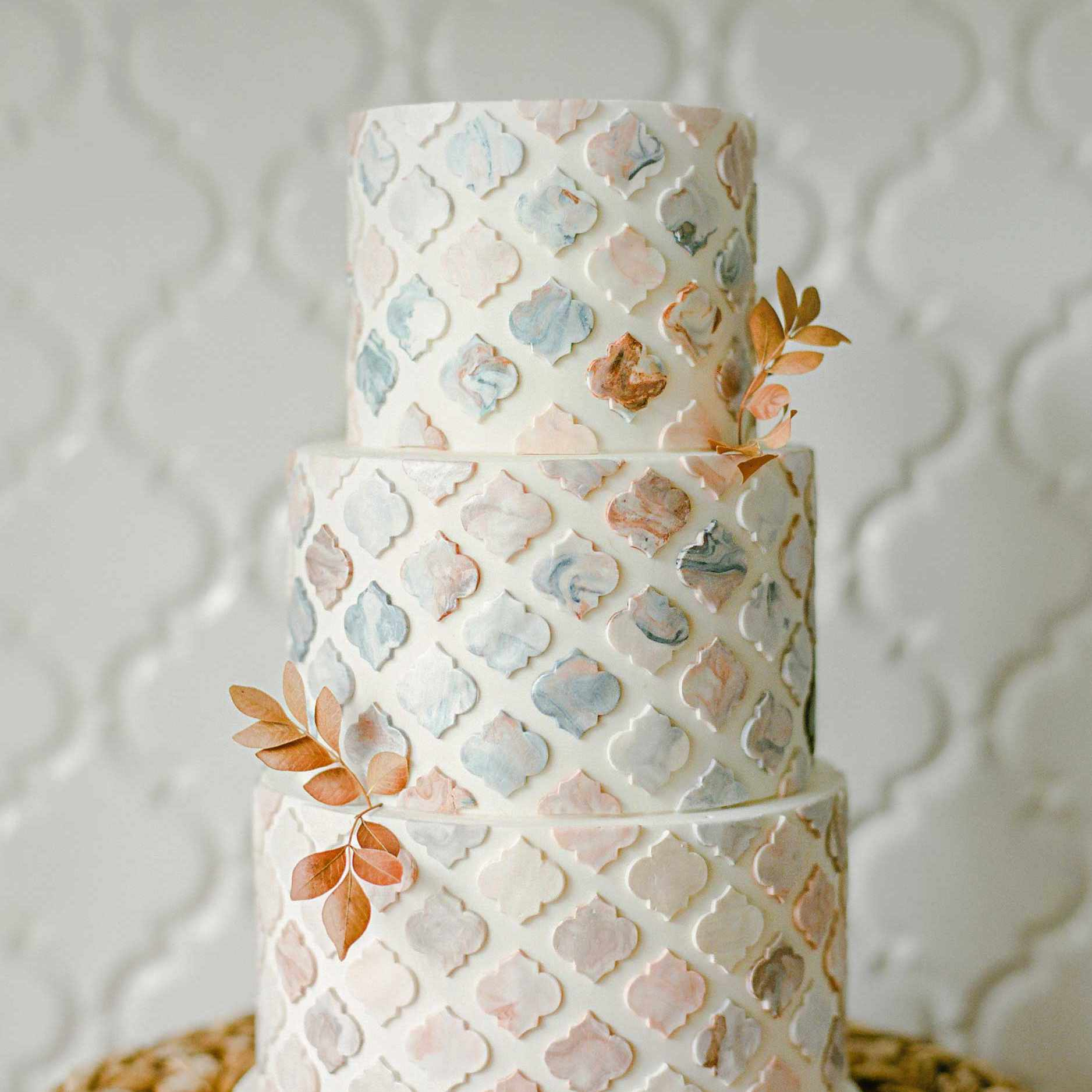 Fall themed wedding cake with hand-painted tile design