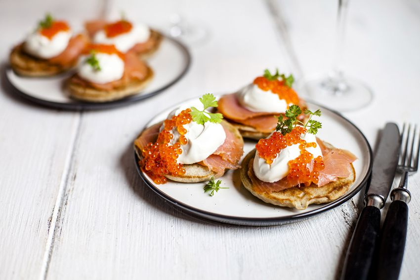 Russian style blini with salmon, sour cream and trout roe