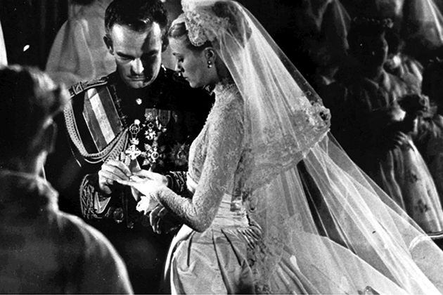 Prince Rainier putting on Grace Kelly's wedding ring at their church ceremony