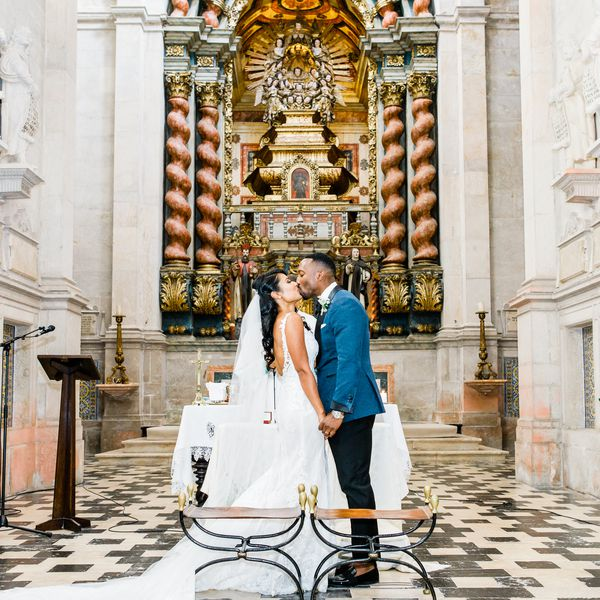 Bride and groom kissing in a church venue