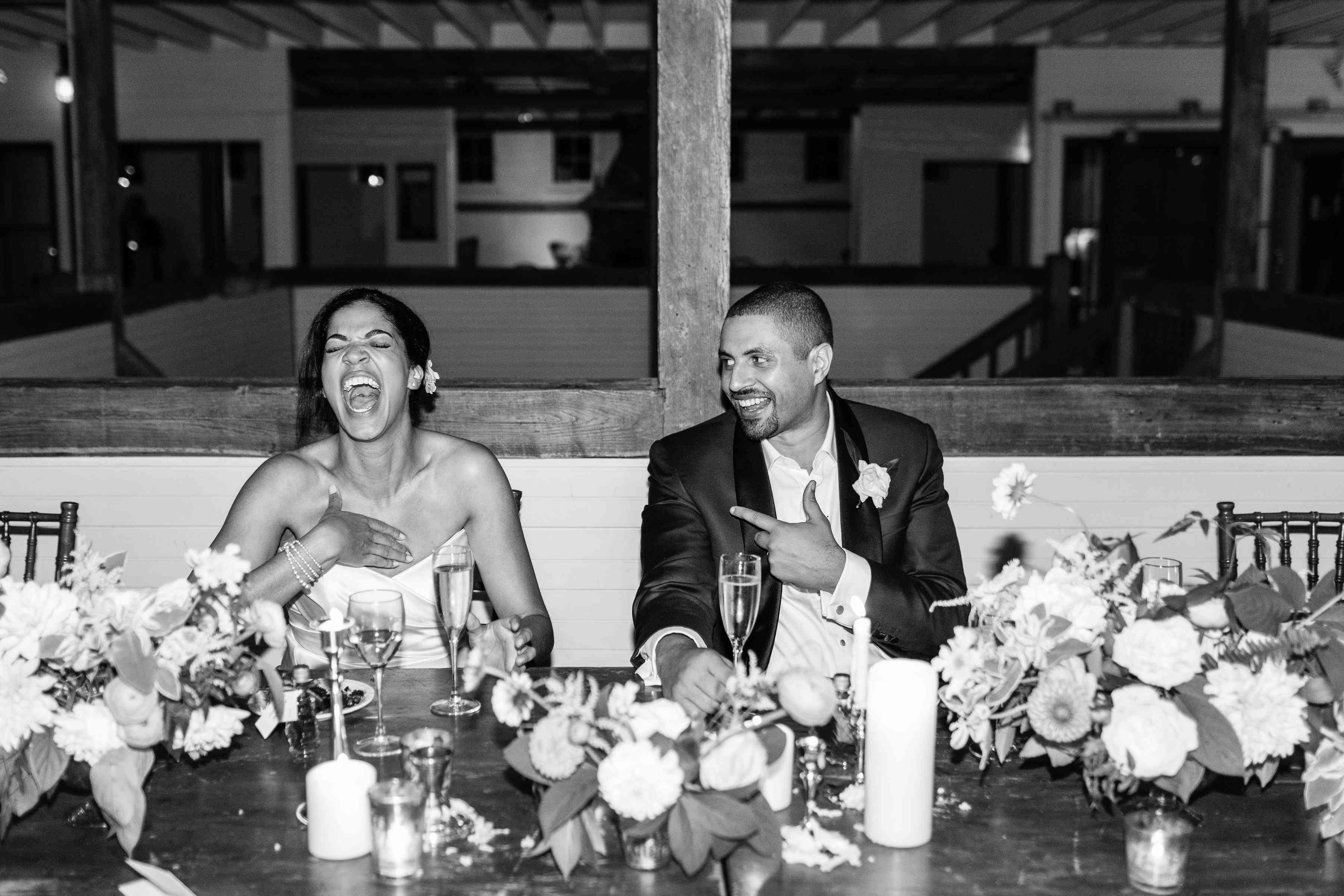 Bride and groom at reception black and white