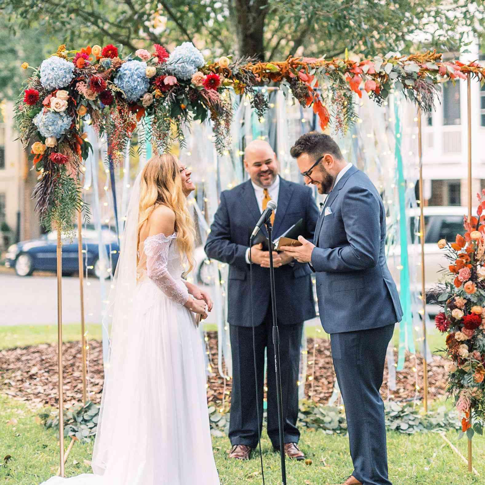 whimsical savannah wedding, bride and groom exchanging vows