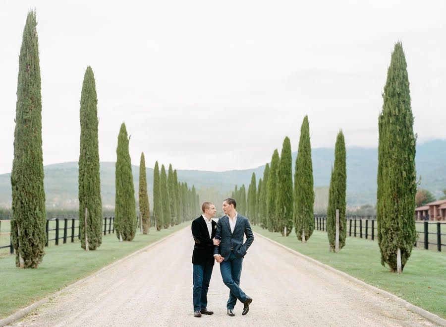 Couple amongst Cyprus trees in Italy