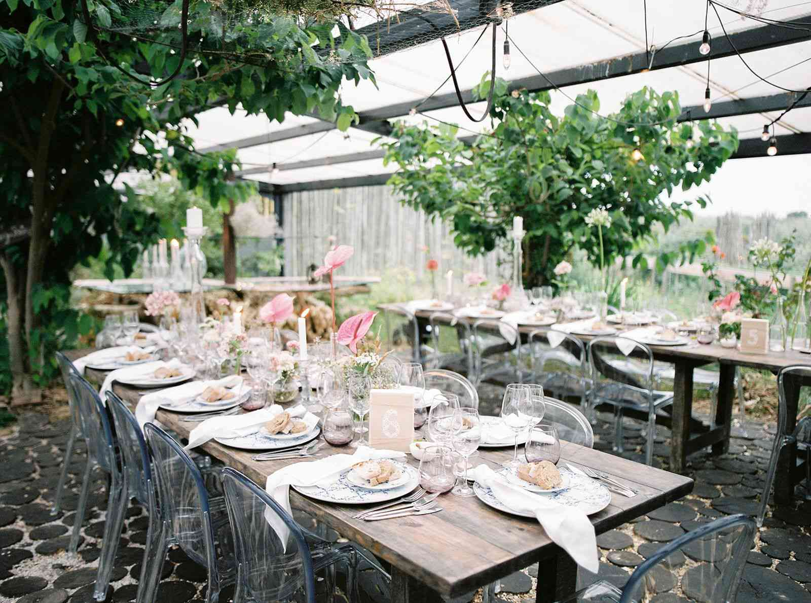 Hanging greenery over small reception tables