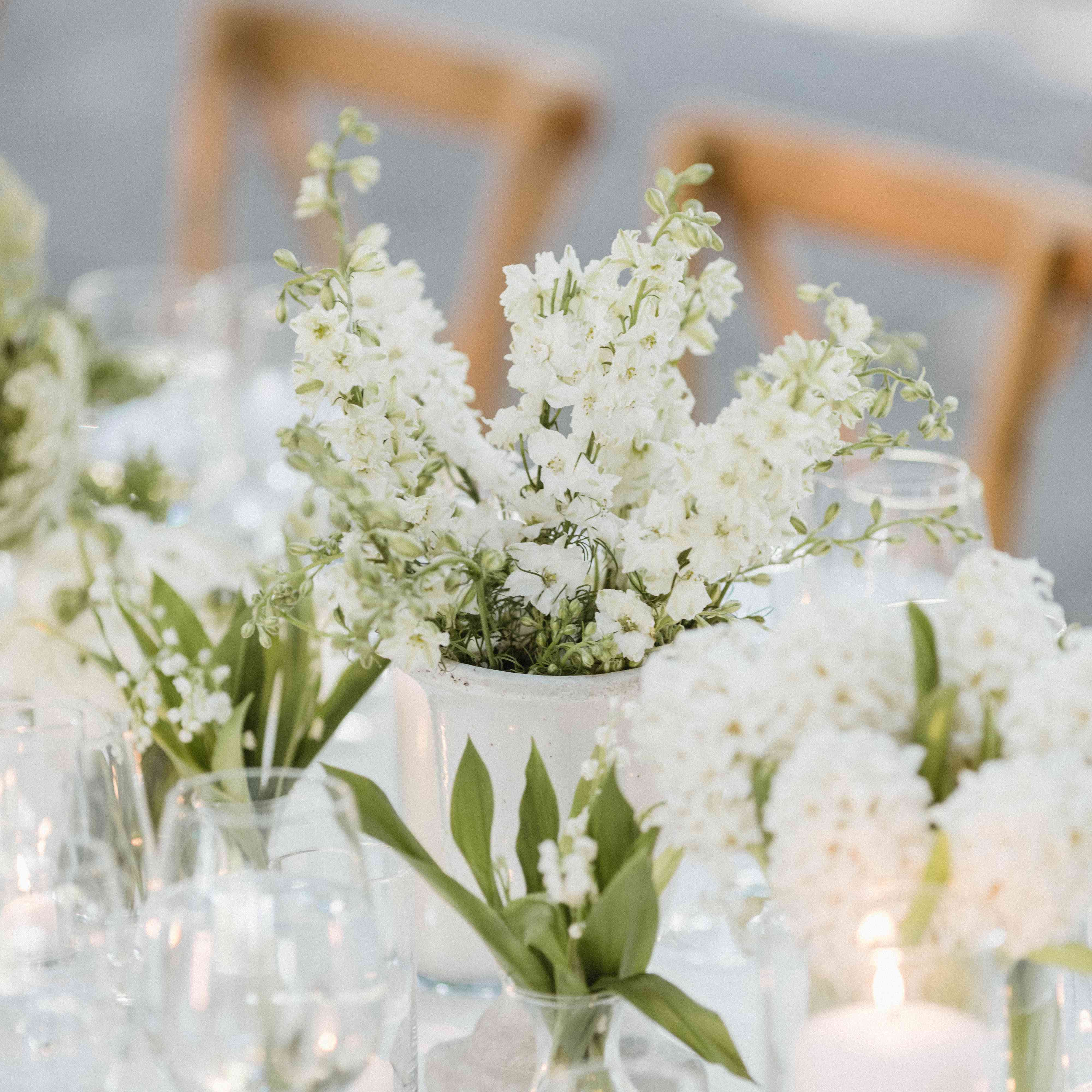 white floral centerpieces with lily of the valley