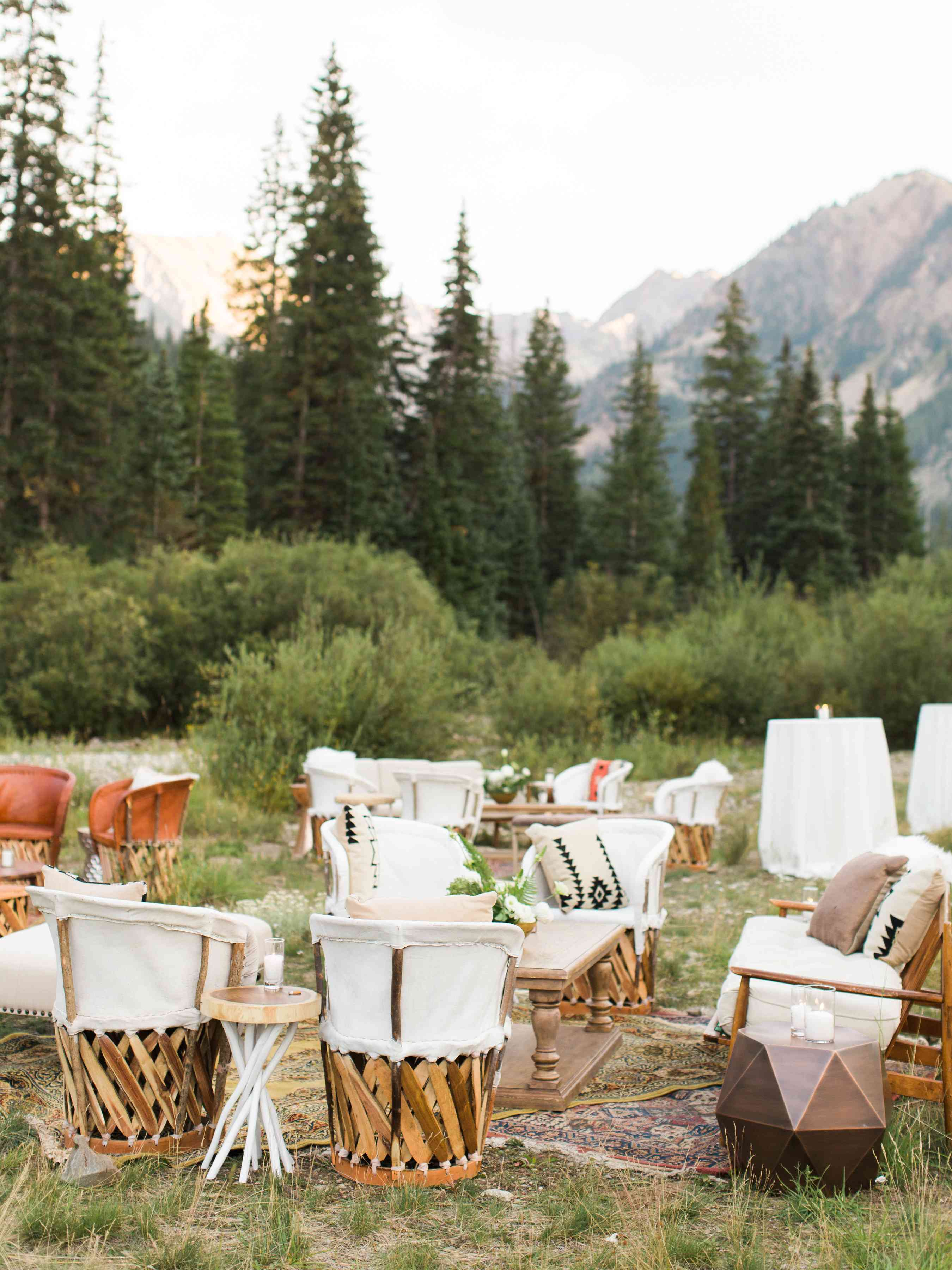 Set up of chairs and couches for an outdoor reception