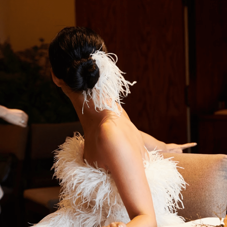 Bride with feathers in her bun