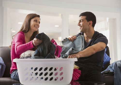Couple splitting the chores