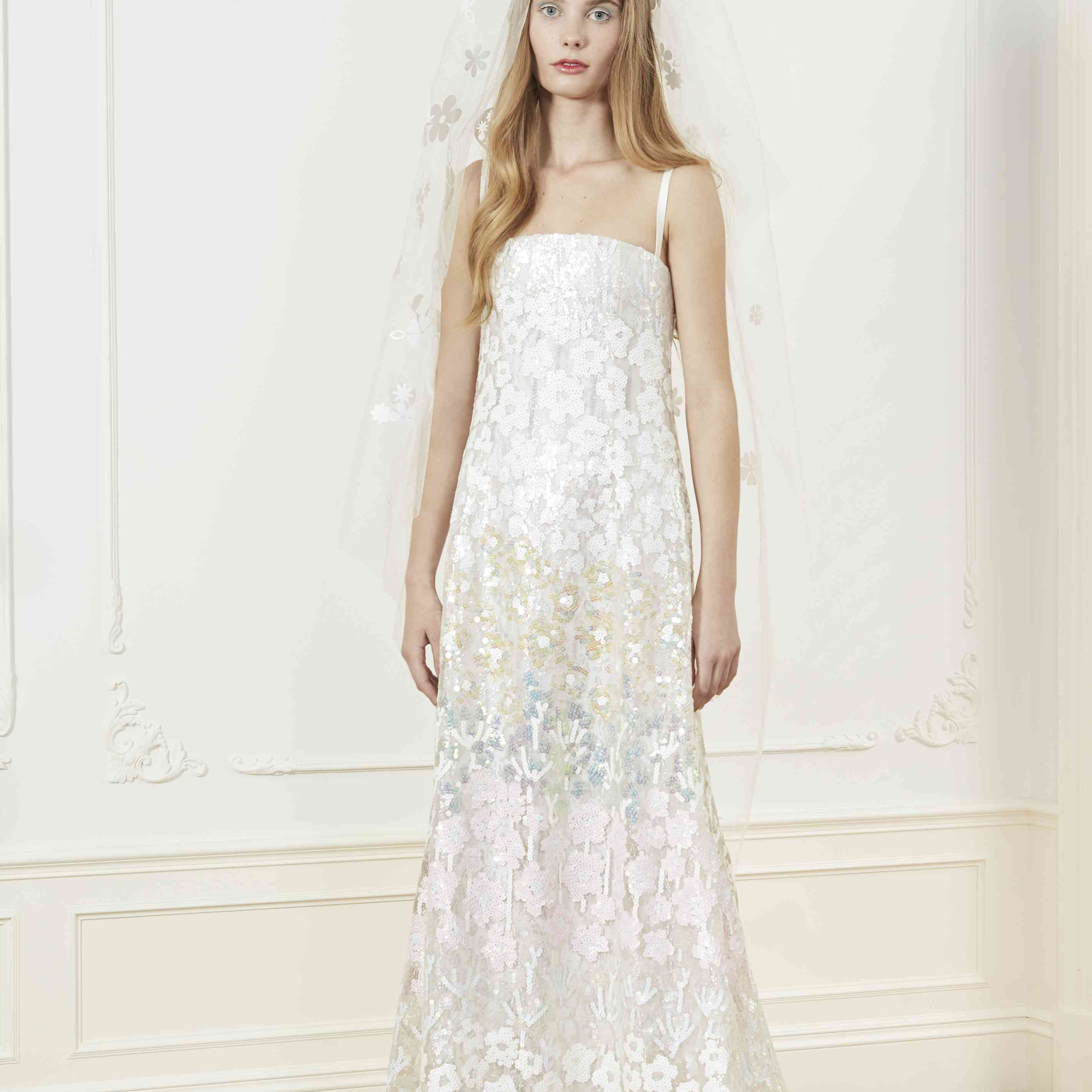 Model in A-line floral wedding dress with slim straps