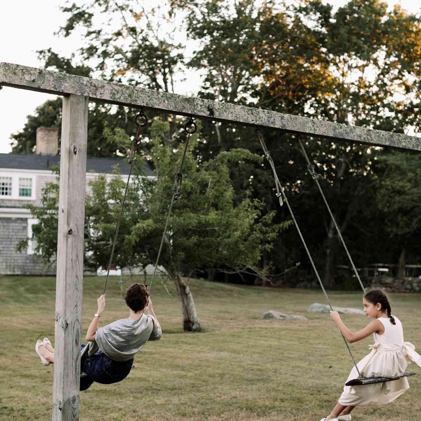 at-home rustic massachusetts wedding, children swinging reception