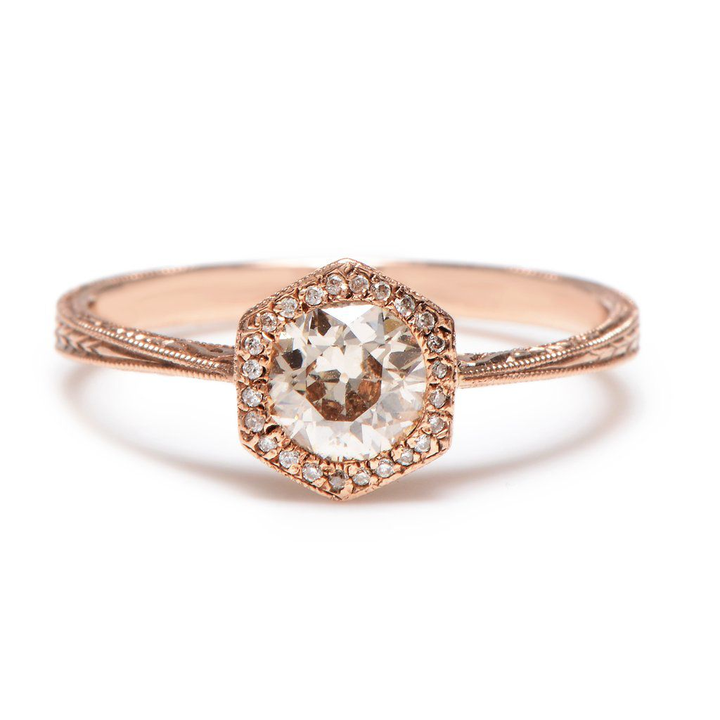 Round diamond with hexagon shaped diamond crown in rose gold band with engraving