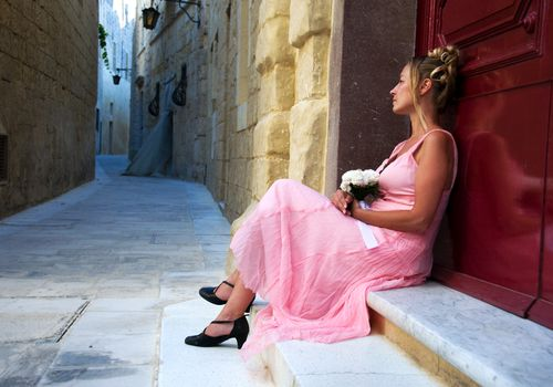 Woman in dress sitting alone