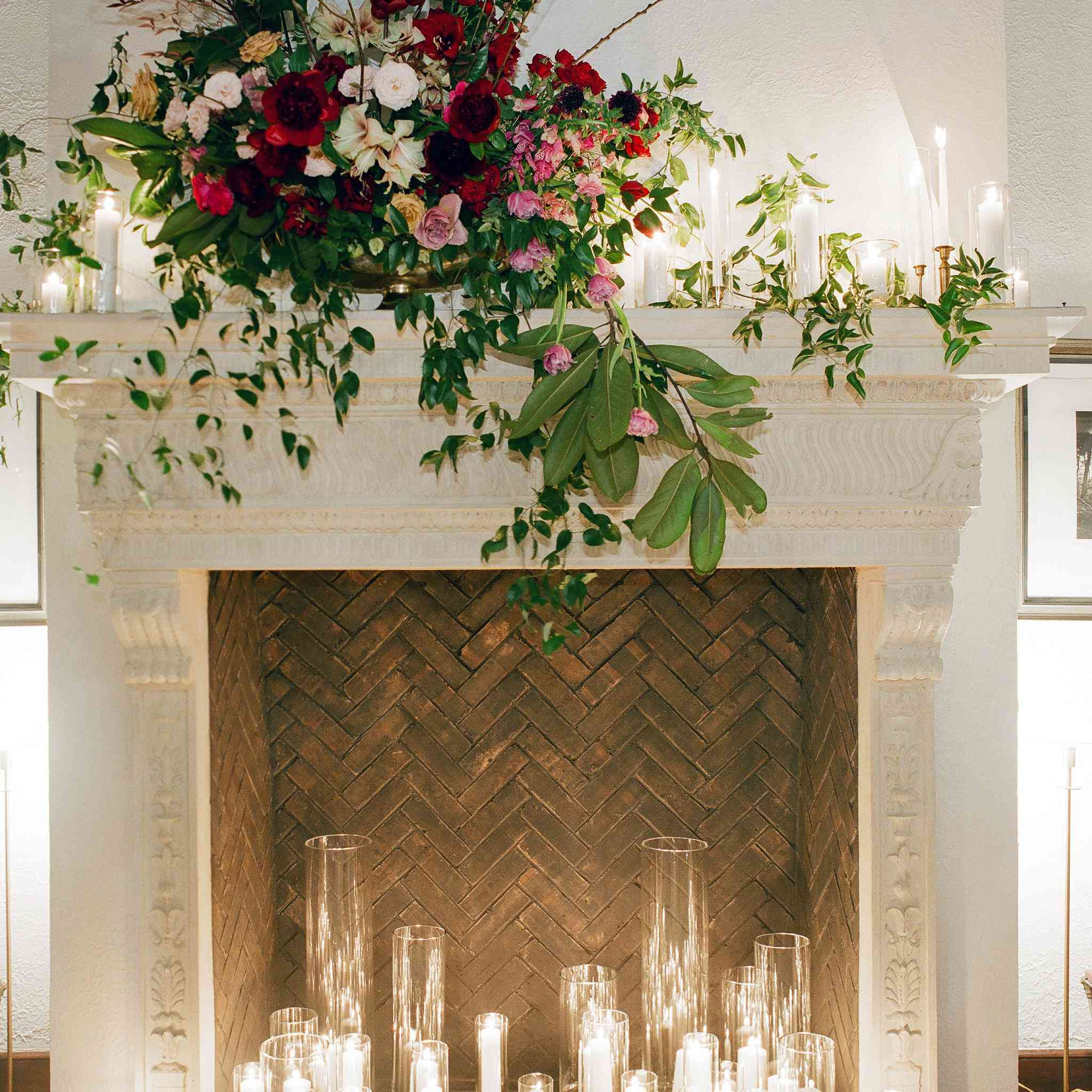 Fireplace with candles and flowers