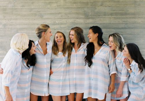 Bride and bridesmaids in matching striped getting ready robes