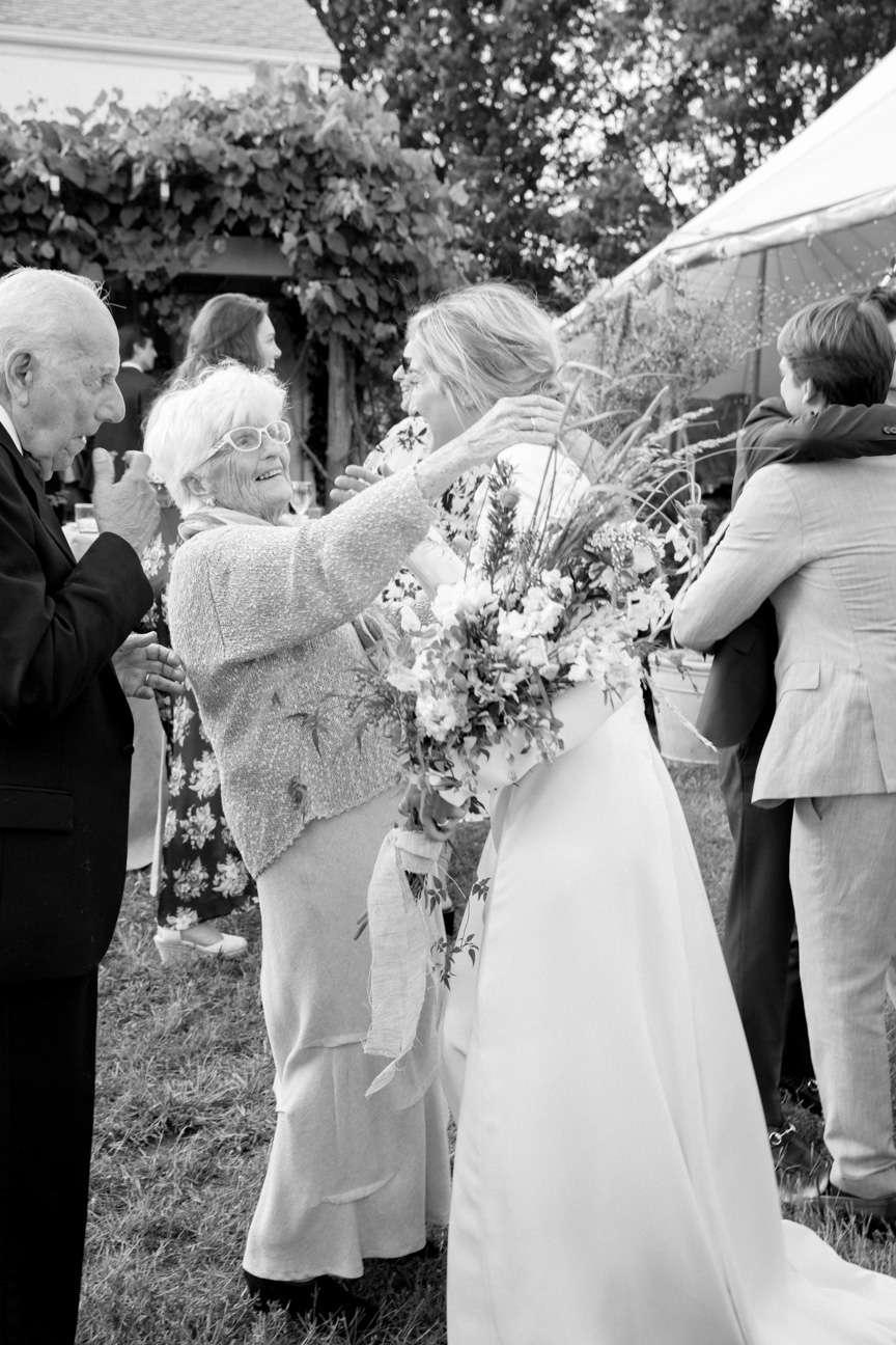 Bride embracing grandparents