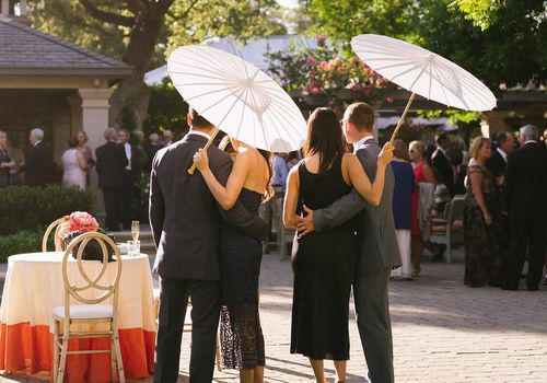 <p>Guests with Parasols</p>