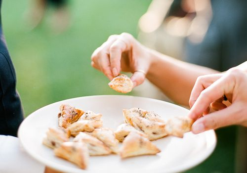 server handing out puff pastries to guests