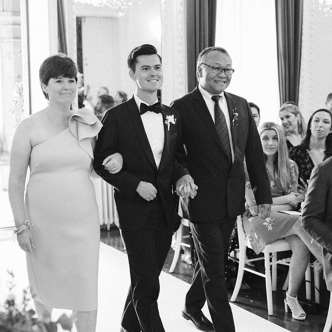 Zach walks up the aisle with his parents