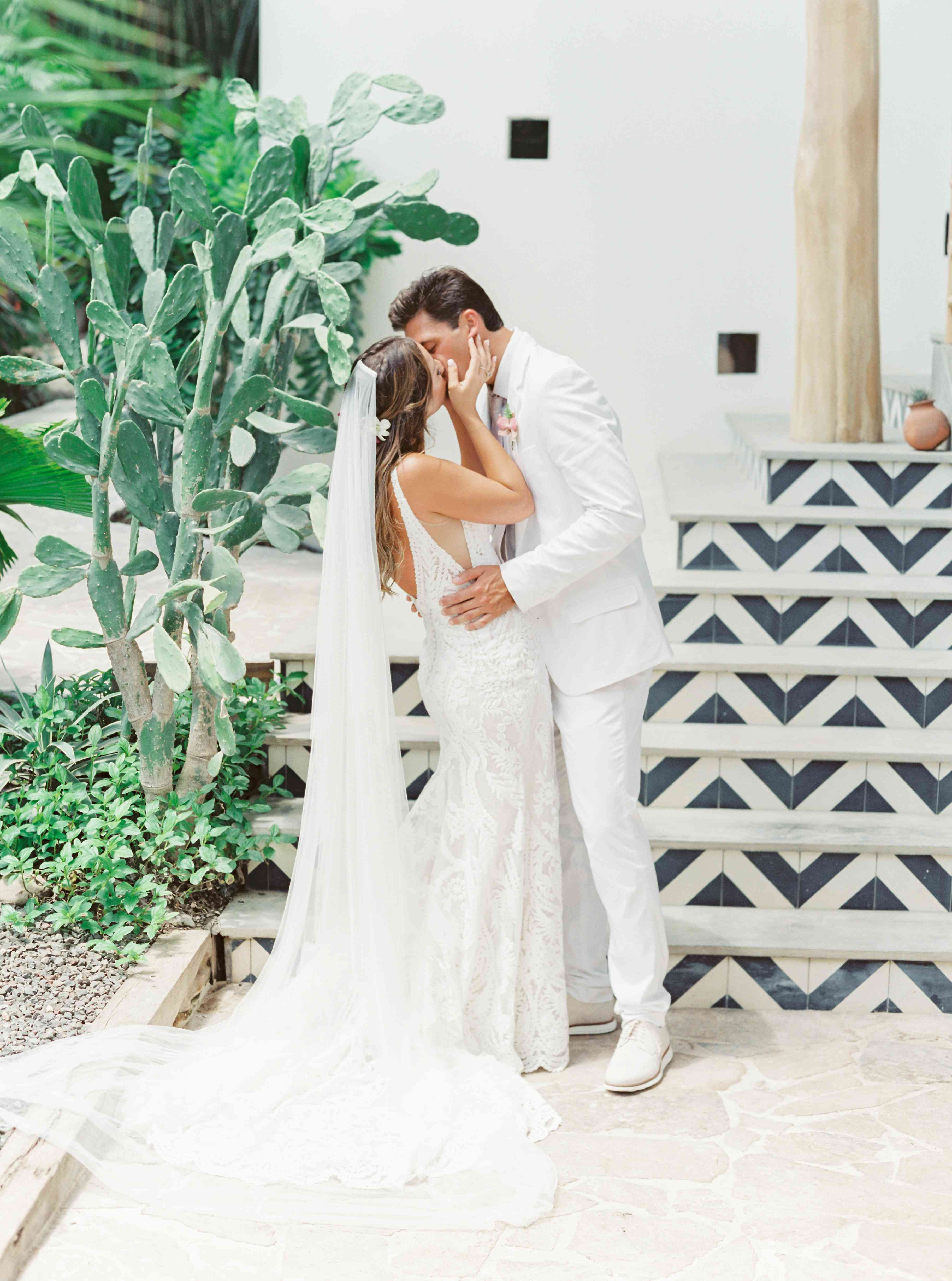 bride and groom kissing