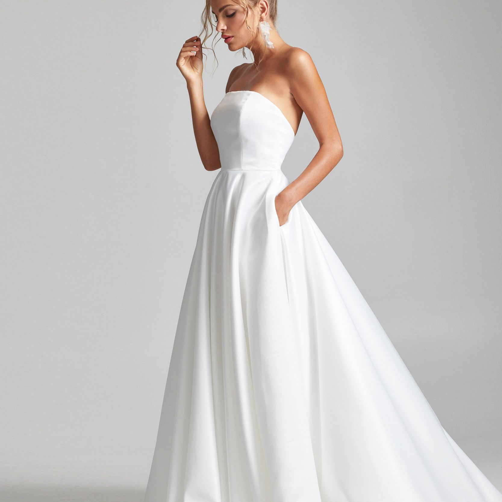 Model in strapless A-line wedding gown