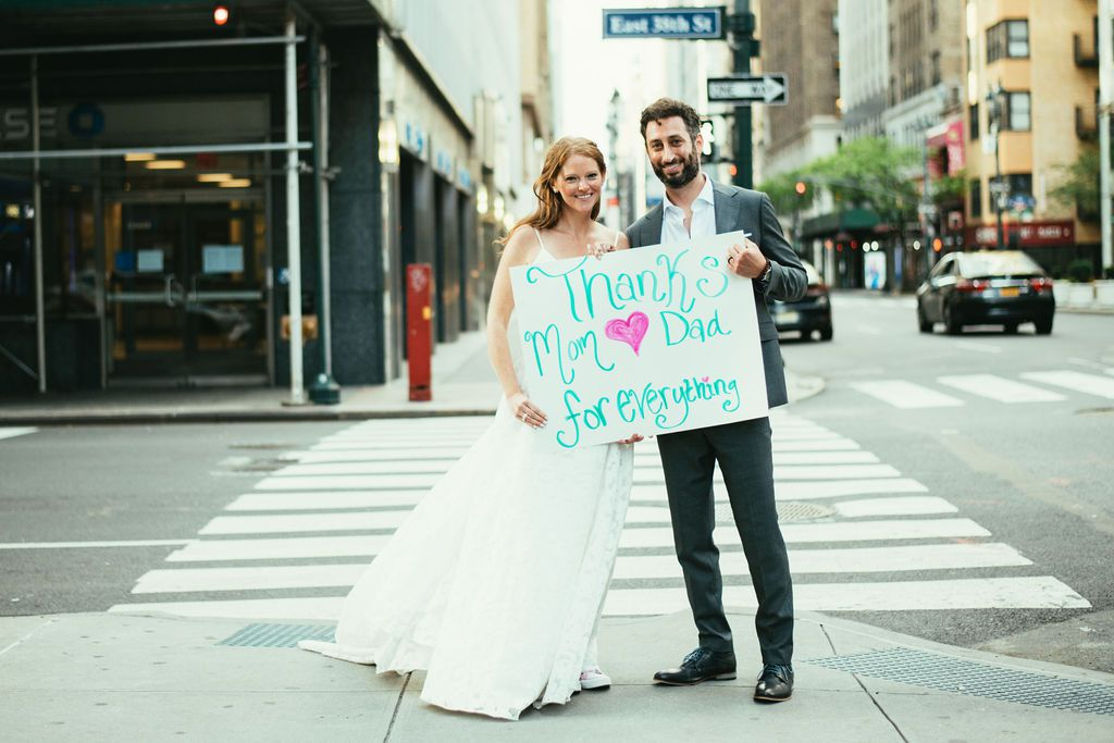 couple holding sign