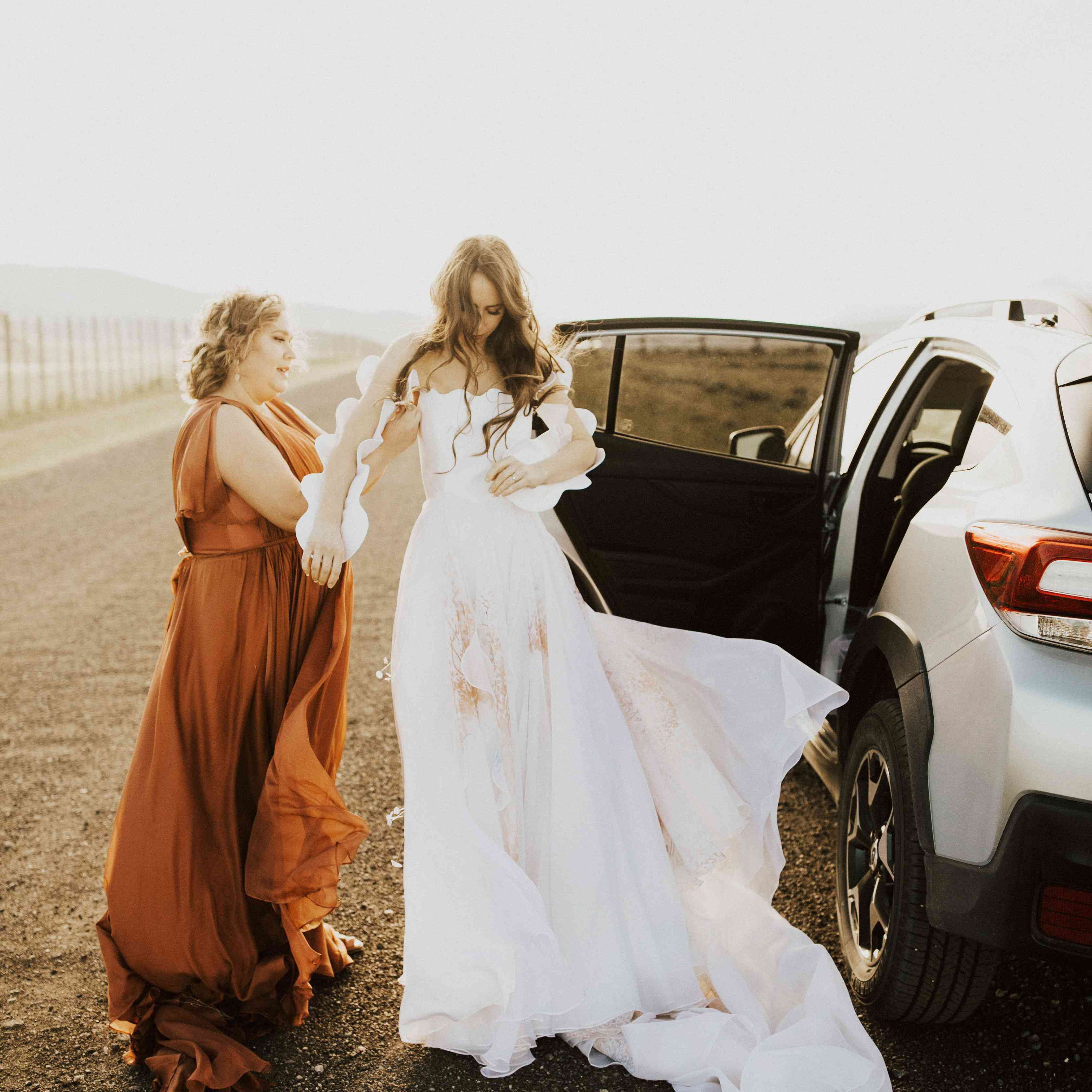 bride getting ready with bridesmaid