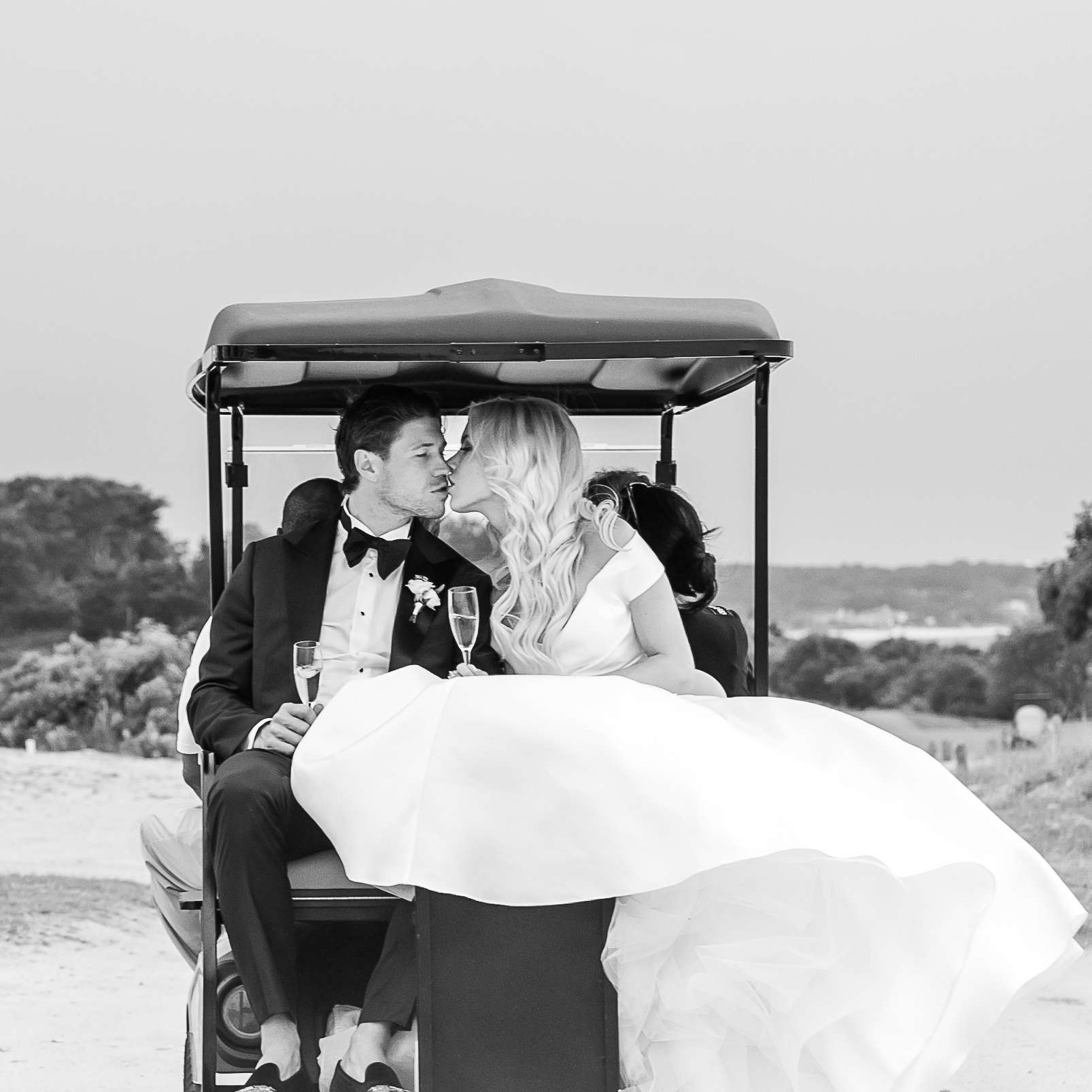 Newlyweds in golf cart