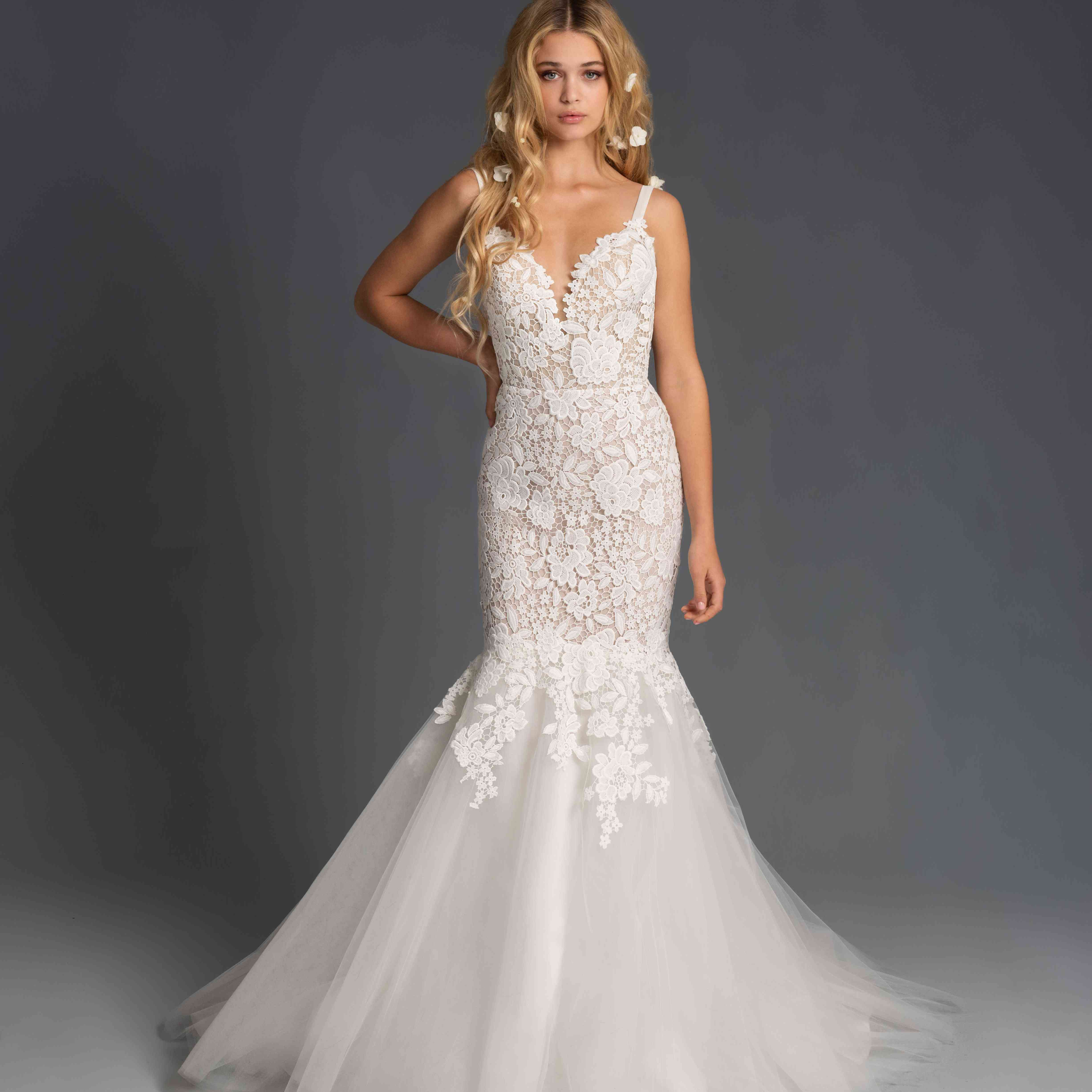 Model in lace fit-and-flare wedding dress