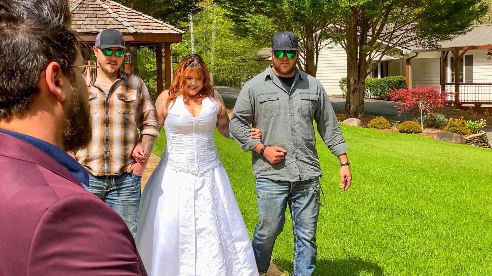90 Day Fiancé star Rebecca Parrott is escorted down the aisle in a white wedding gown.