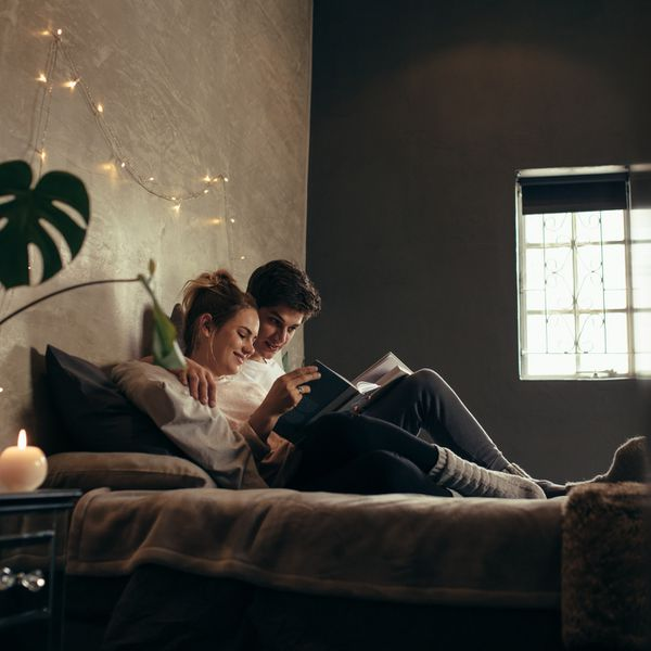 Couple reading and relaxing in bed