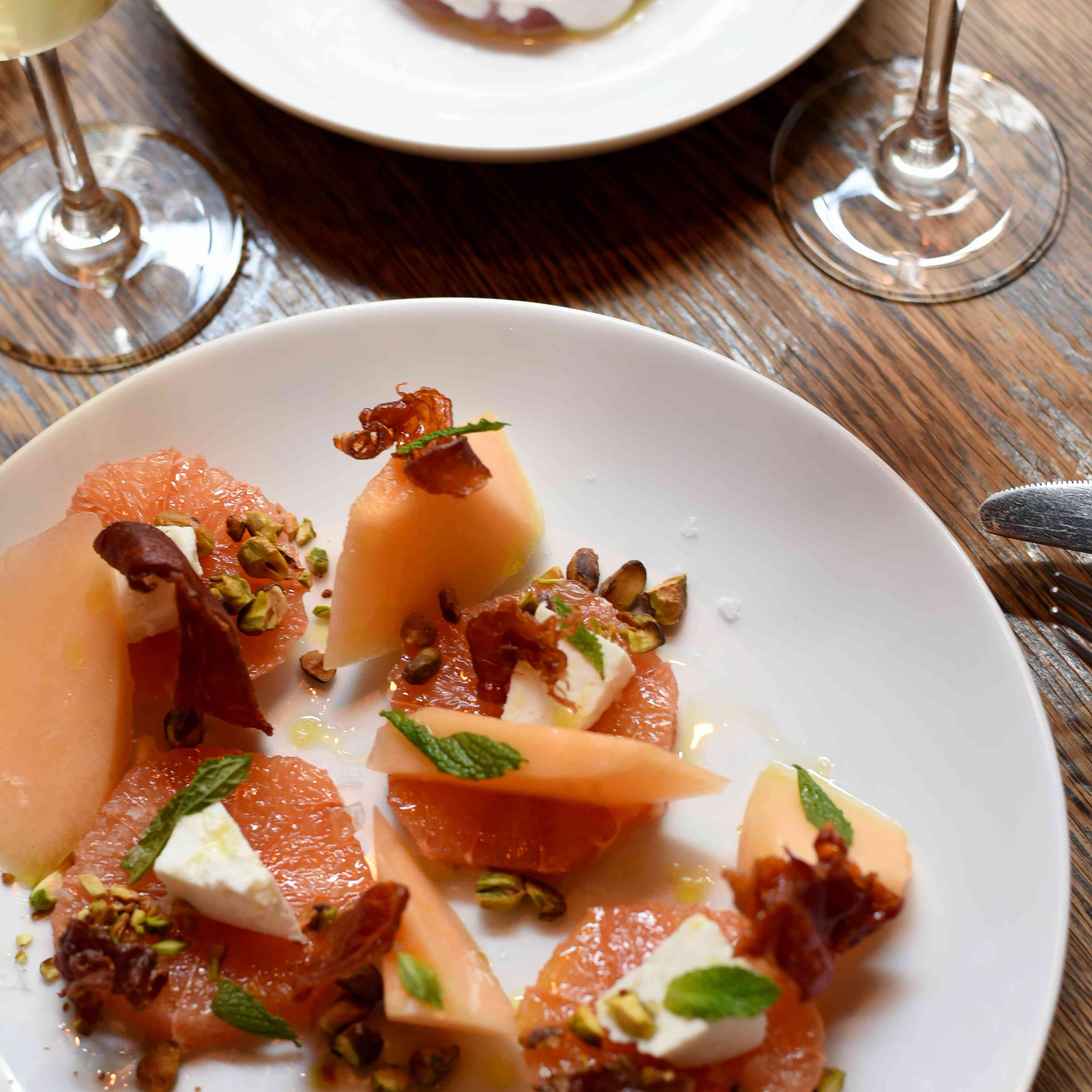 Citrus and melon with cheese and nuts