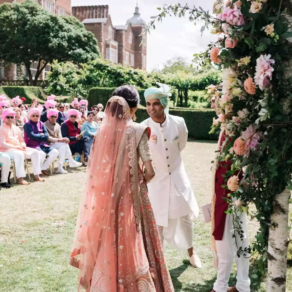 Wedding guests in pink turbans
