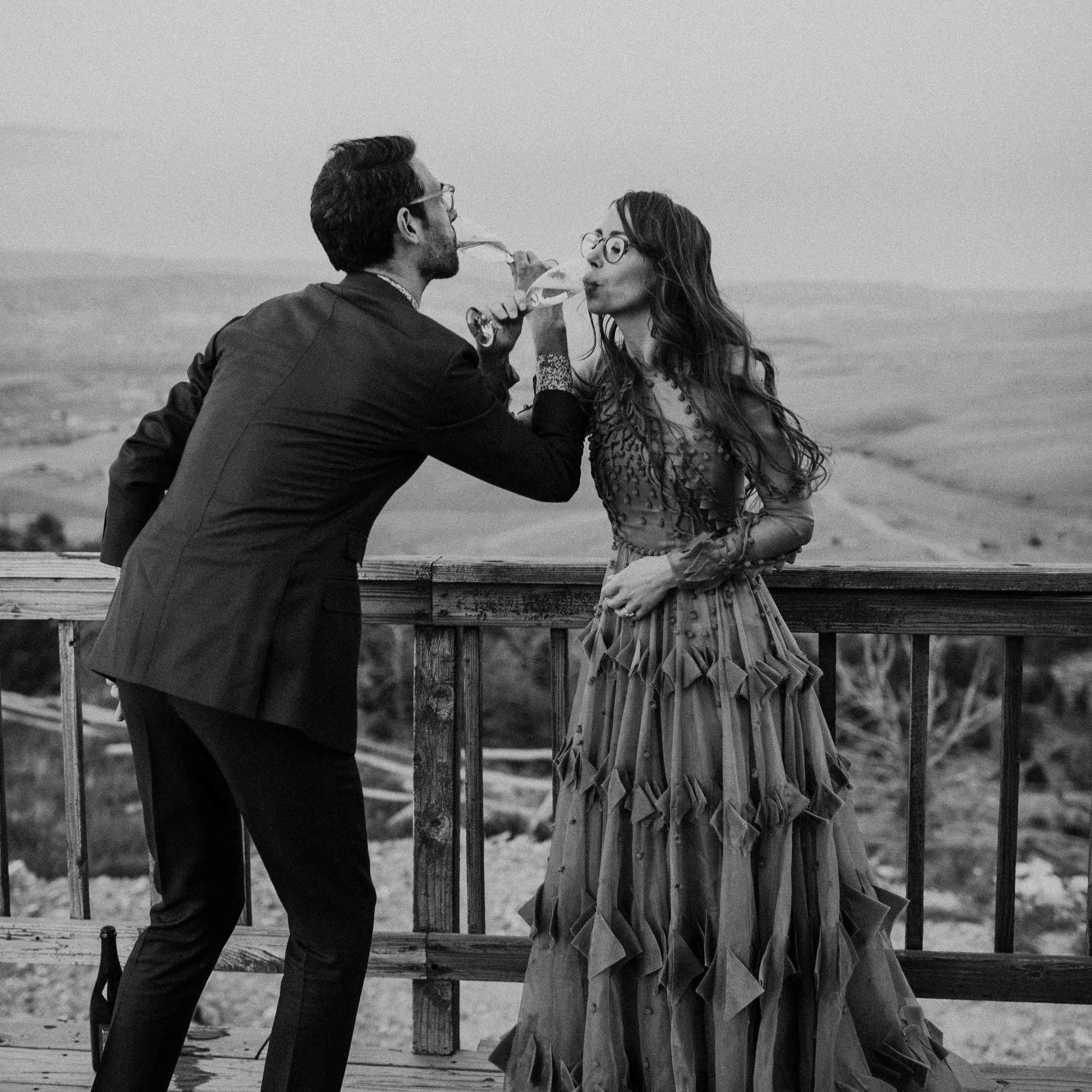 couple toasting locking arms