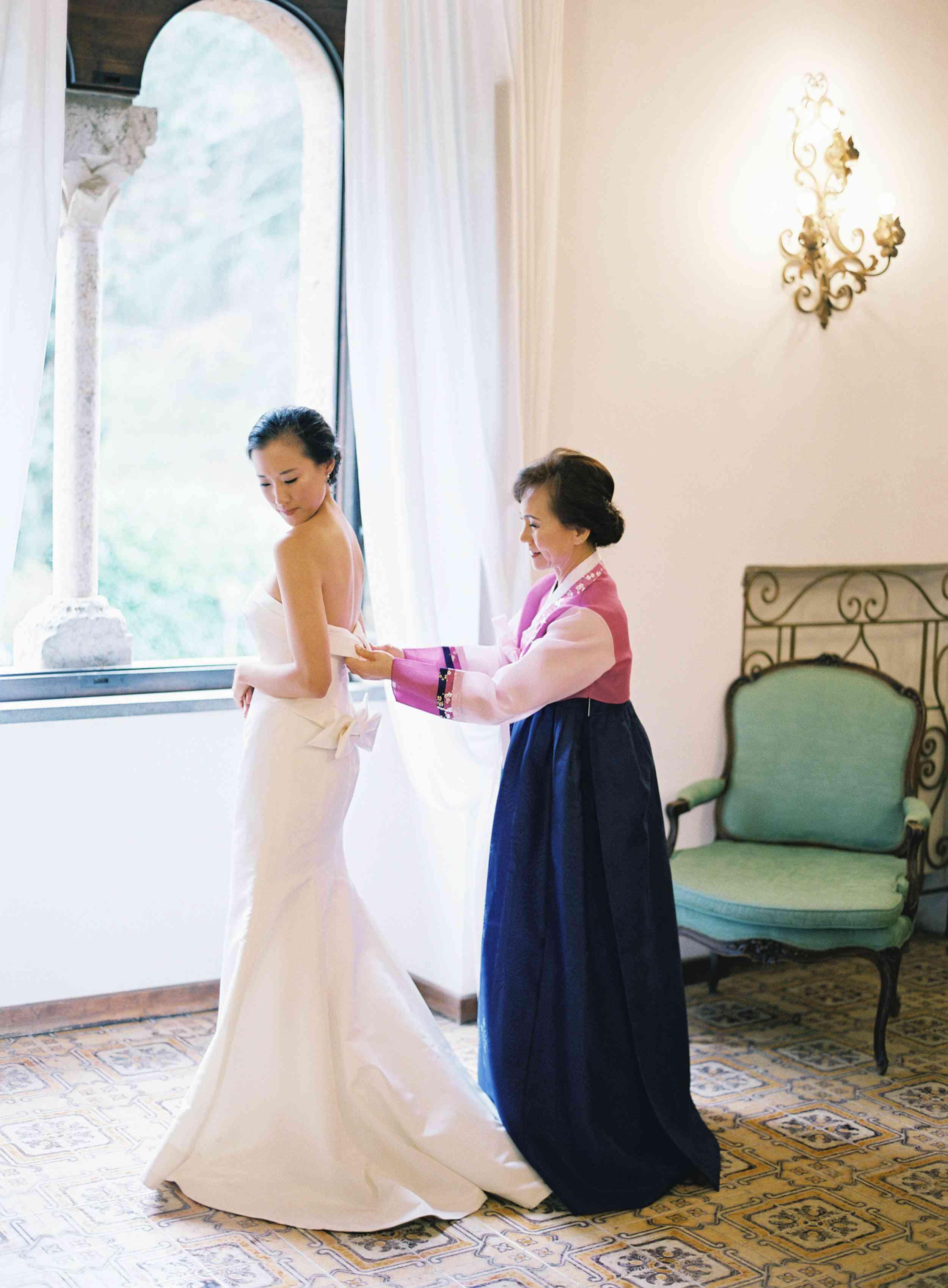 classic la badia italian wedding, mother helping bride wedding dress