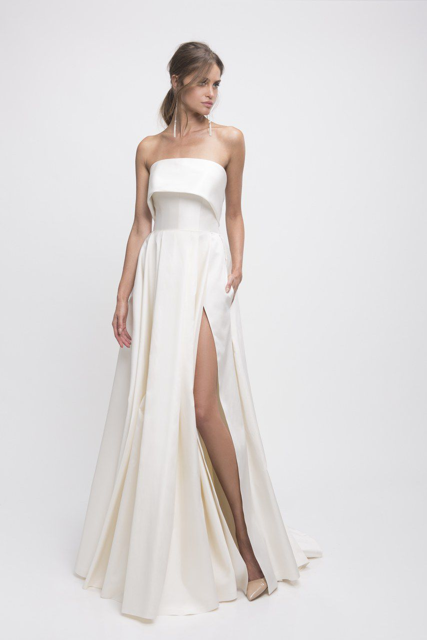 Model in strapless wedding gown with a slit skirt