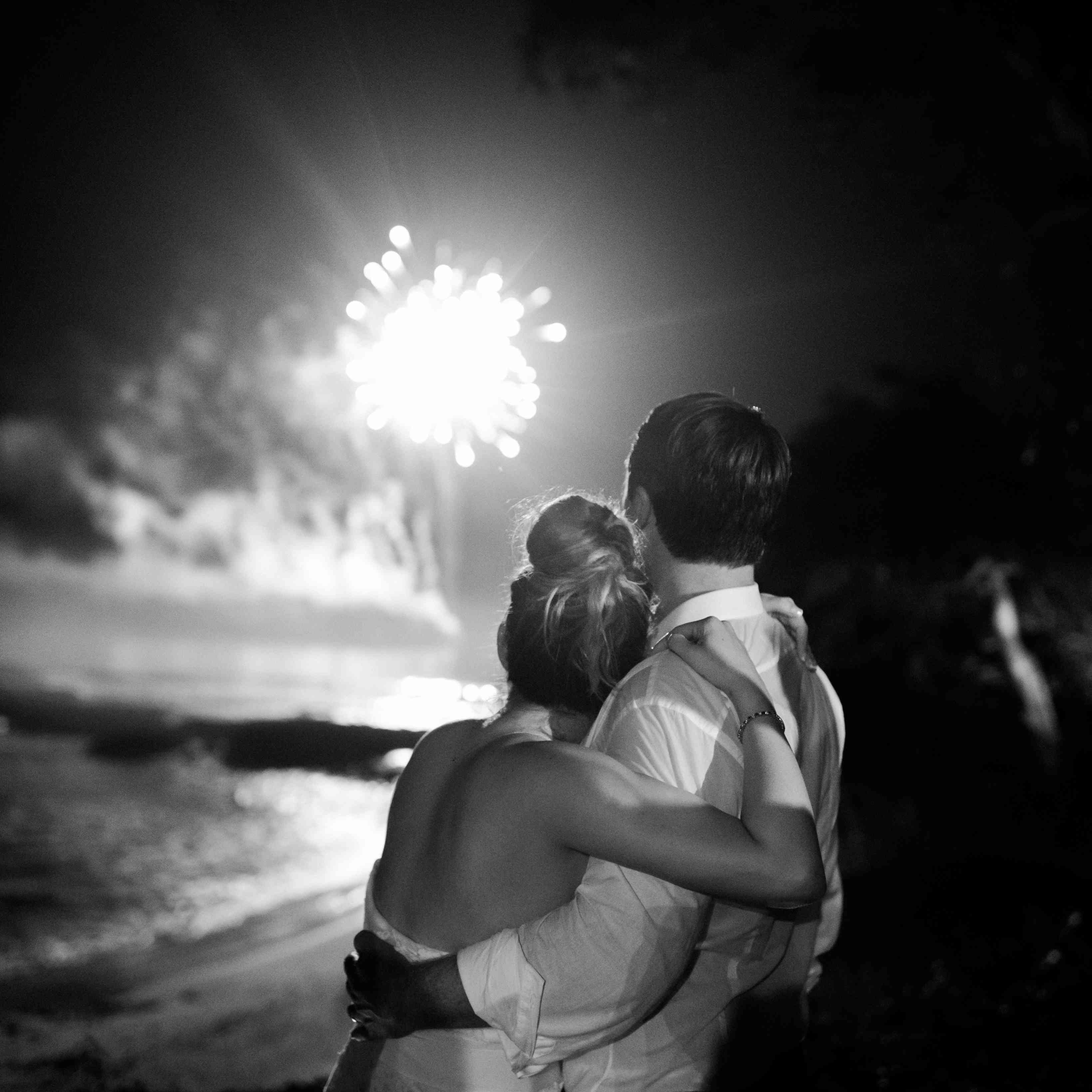 The couple watches a fireworks display