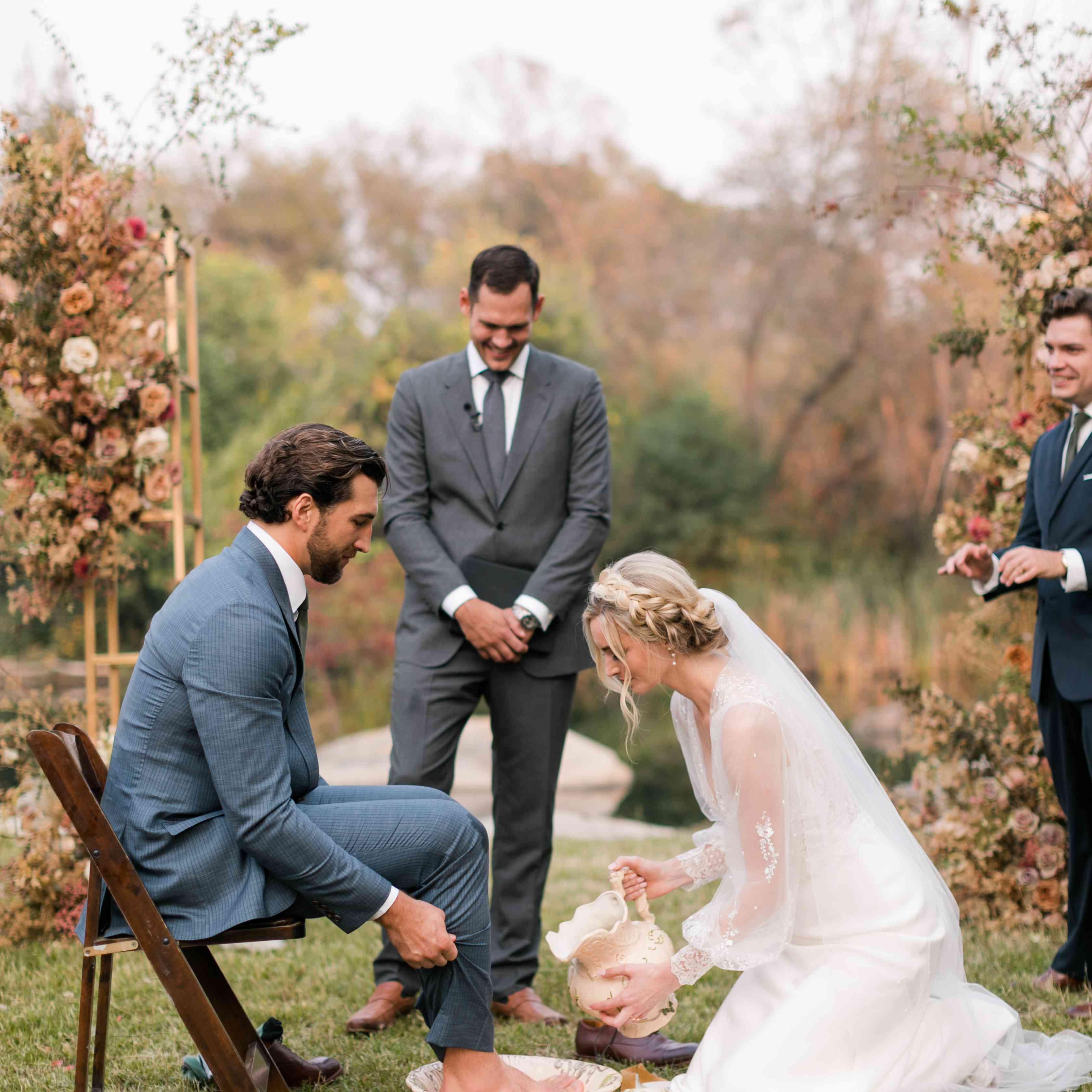 bride washing groom's feet