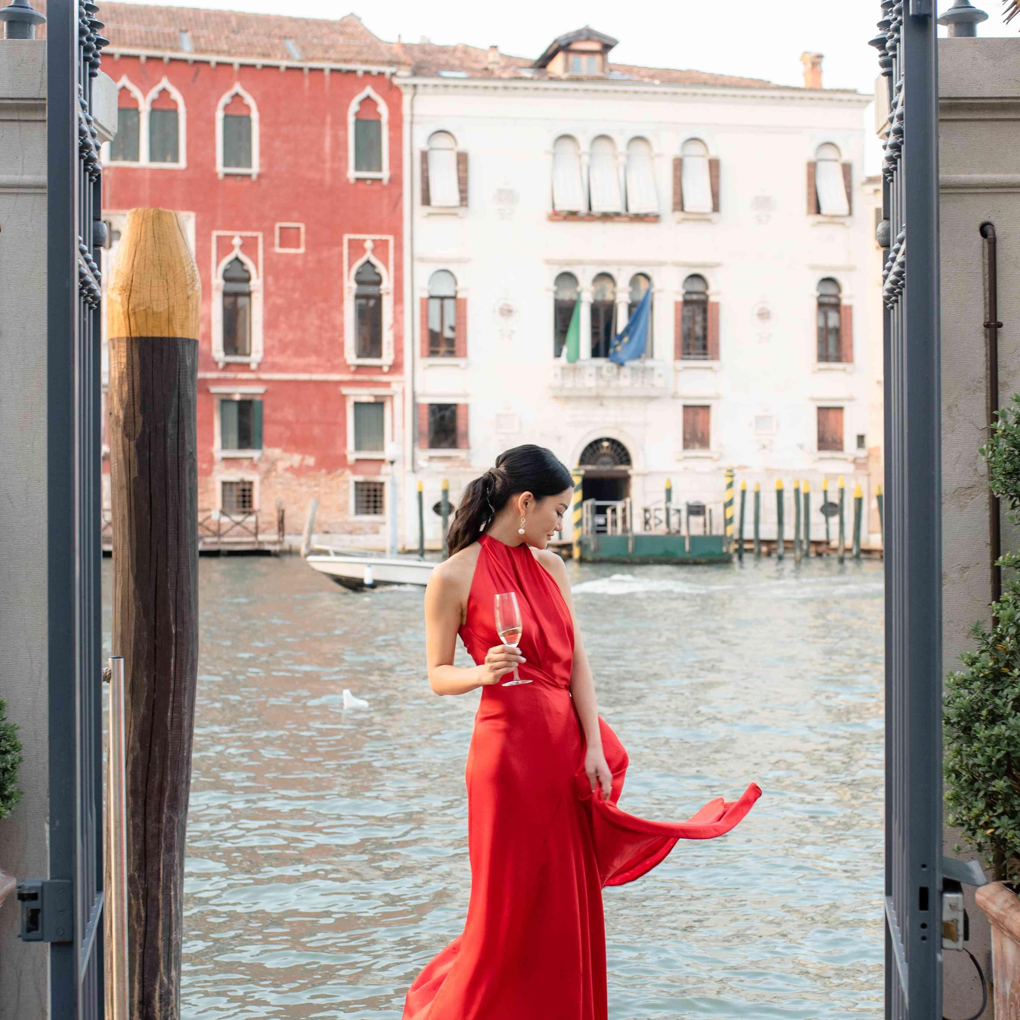 modern venice wedding, bride red dress rehearsal dinner