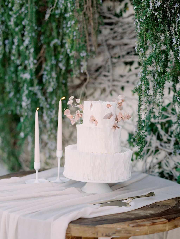 White wedding cake with white linen on table