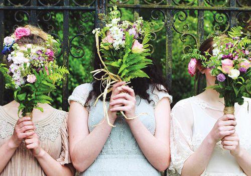 <p>Bridesmaids Holding Bouquets</p>