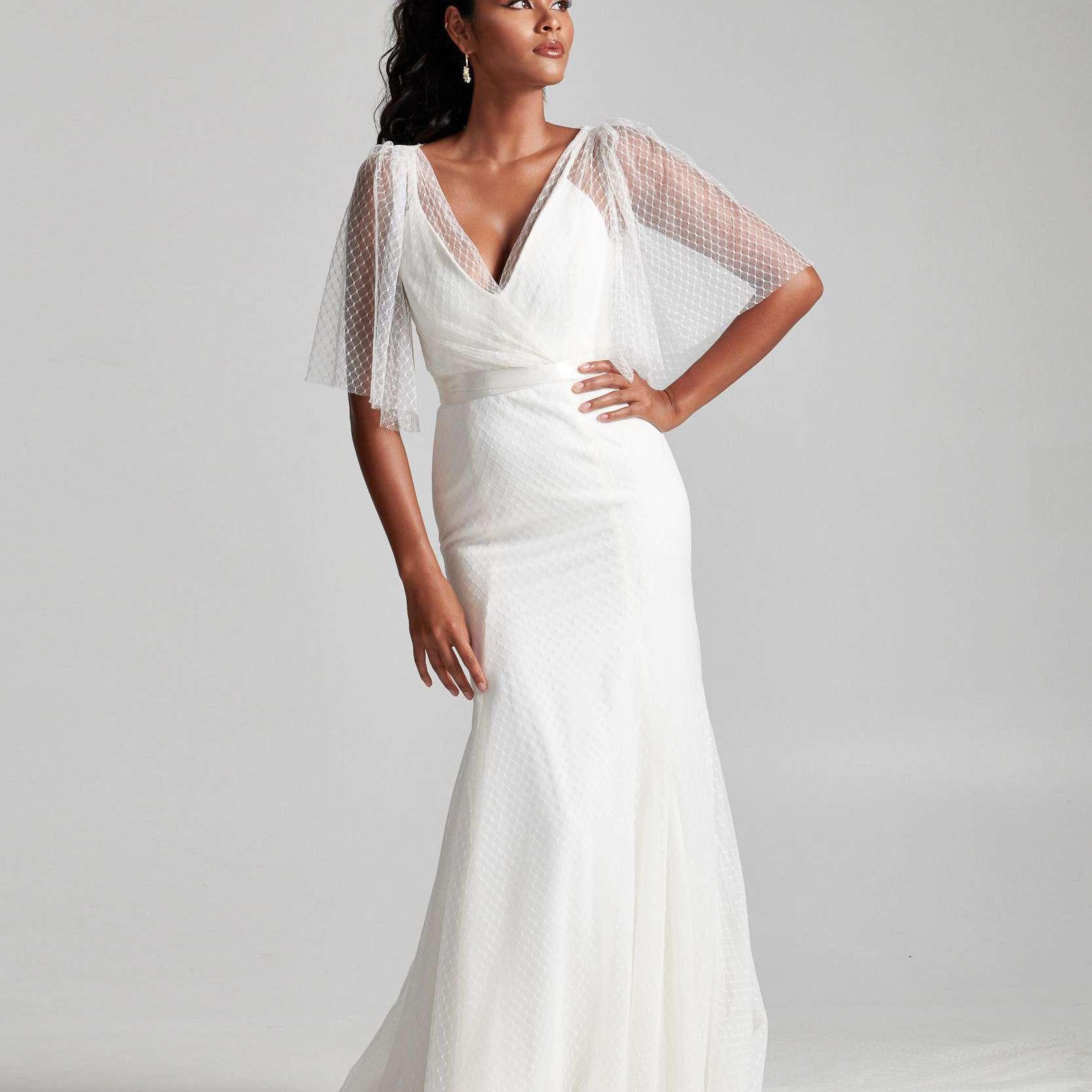 Model in V-neck wedding dress with sheer topper