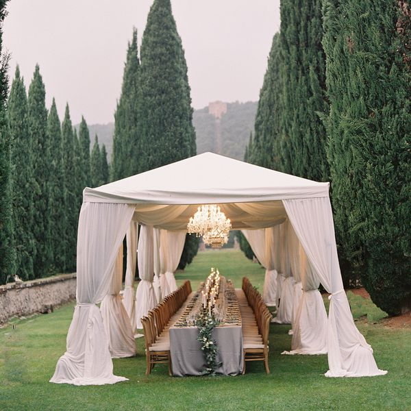 wedding tent with chandelier and table set up