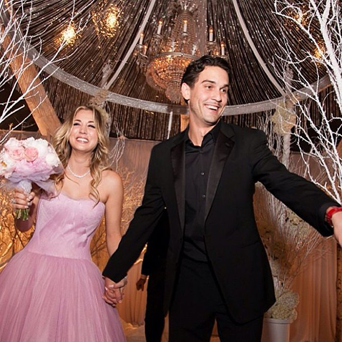 Kaley Cuoco SweetingThe custom pink Vera Wang confection that the Big Bang Theory star wore to marry Ryan Sweeting at their New Year's Eve wedding strongly evoked Wang's Fall 2014 runway collection , which she designed in shades of pink. Cuoco donned the strapless tulle ball gown with a sweetheart neckline for the ceremony before changing into a shorter red dress for the reception
