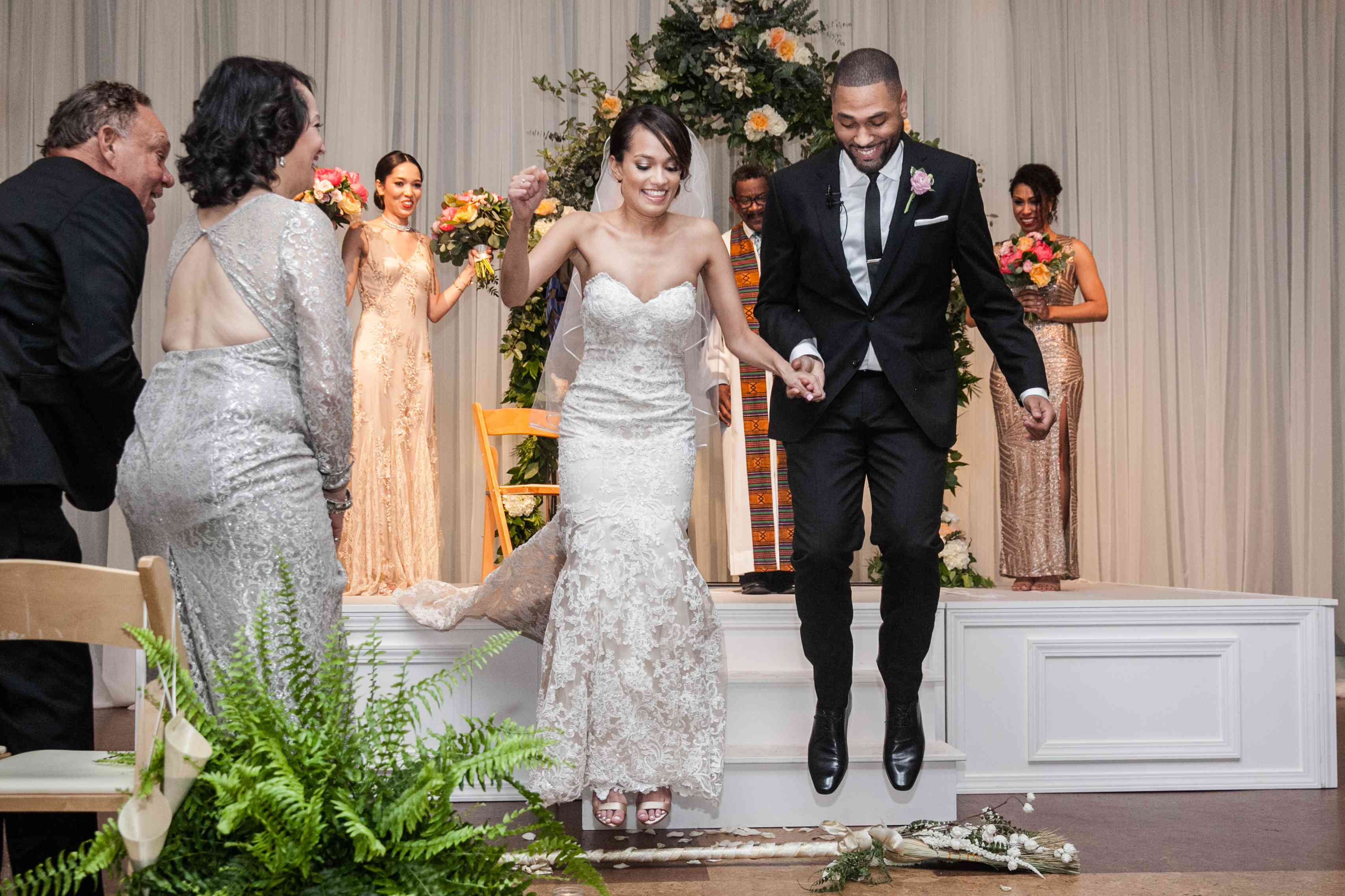 <p>Bride and Groom Jump the Broom</p><br><br>