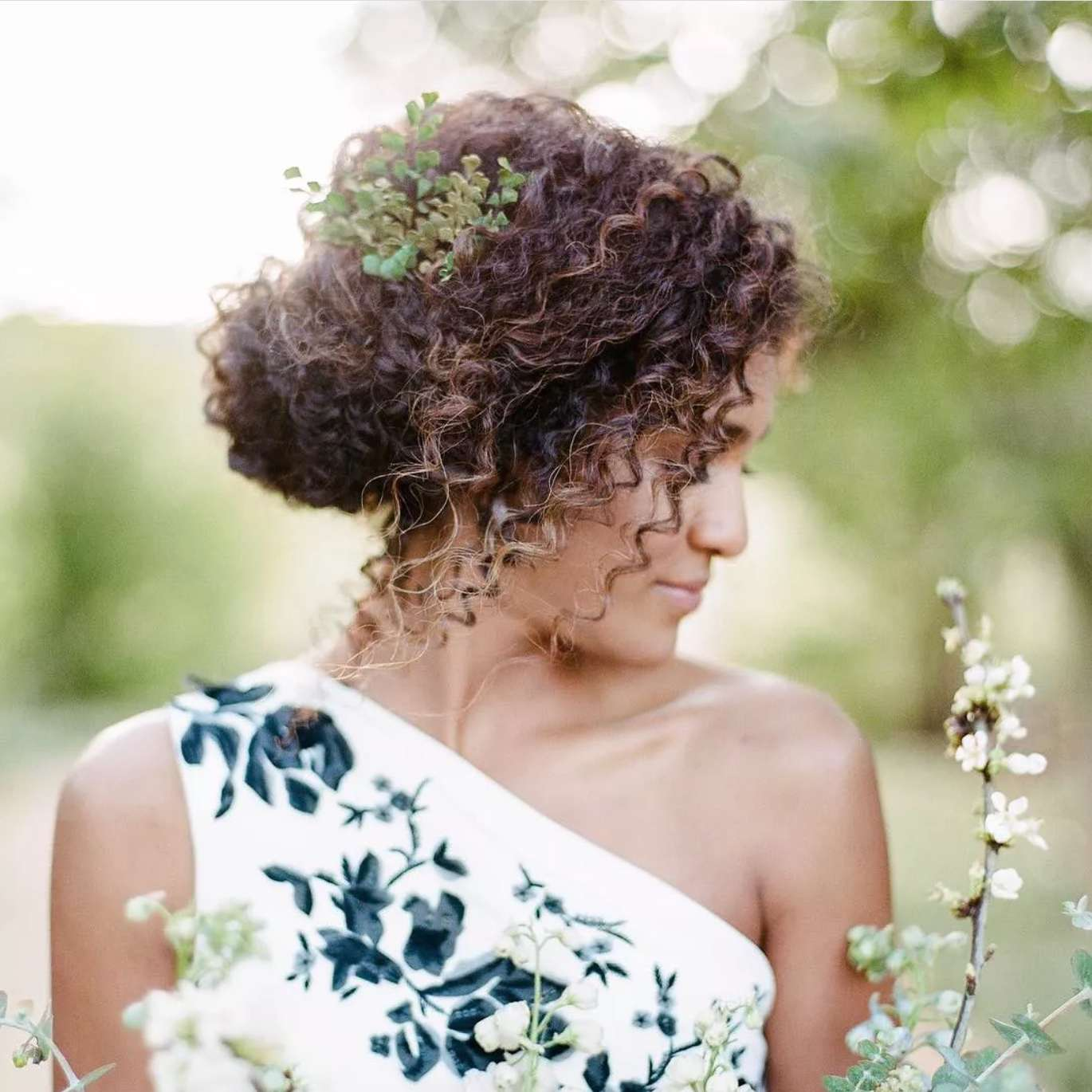 Curly chignon with greenery